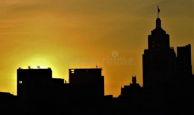 Silhouette of buildings at sunset.. stock photography