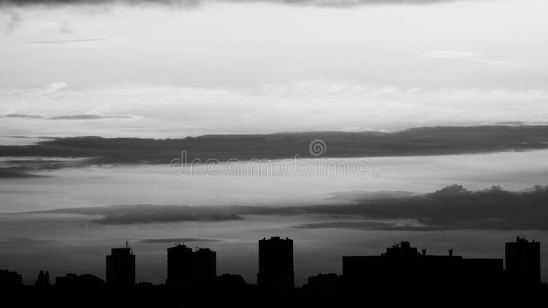 Silhouette Of Buildings Under Gray Clouds Free Public Domain Cc0 Image
