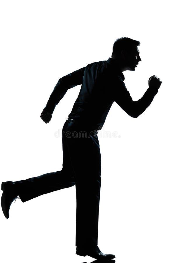 Silhouette business man running full length royalty free stock image