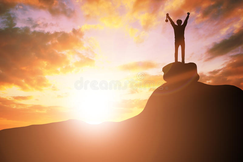 Silhouette business people victory raising hands and holding gold medal with sunset sky on mountain. Motivation and success royalty free stock photos