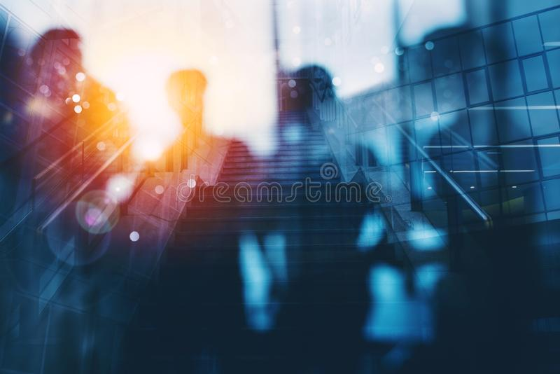 Silhouette of business people work together in office. Concept of teamwork and partnership. double exposure with light. Business people collaborate together in royalty free stock image
