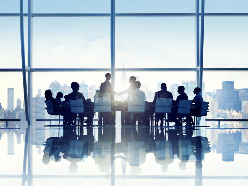 Silhouette of Business Person in a Board Room stock images