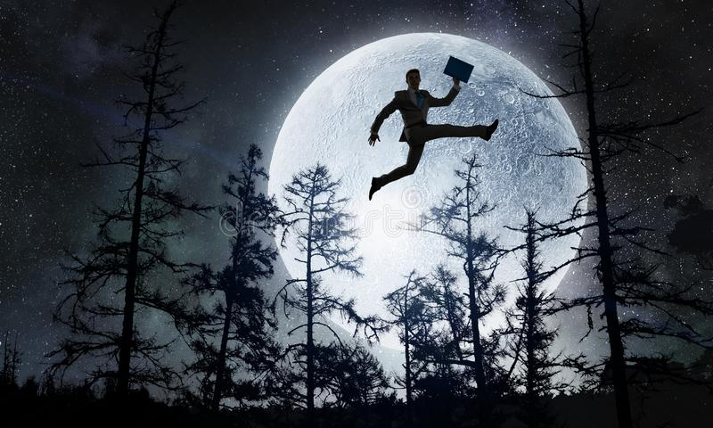 Luna lunera... - Página 11 Silhouette-businessman-over-moon-mixed-media-young-cheerful-jumping-against-full-background-129971064