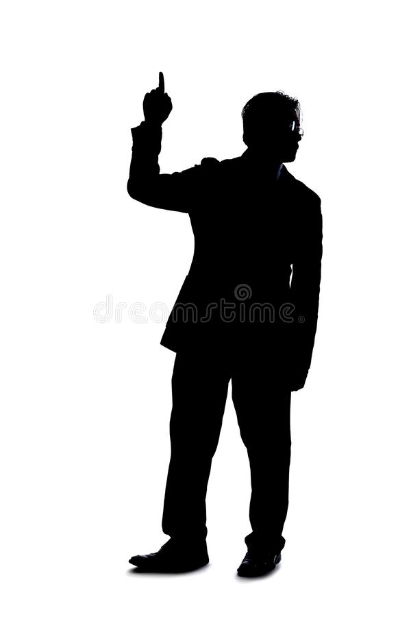 Silhouette of Businessman Pointing at Something stock photos