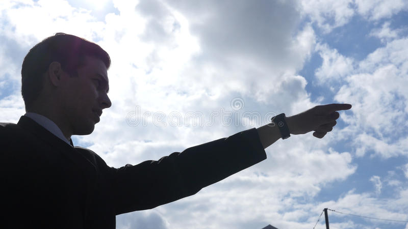 Silhouette of Businessman Showing Direction, Leader Pointing with Finger, royalty free stock images