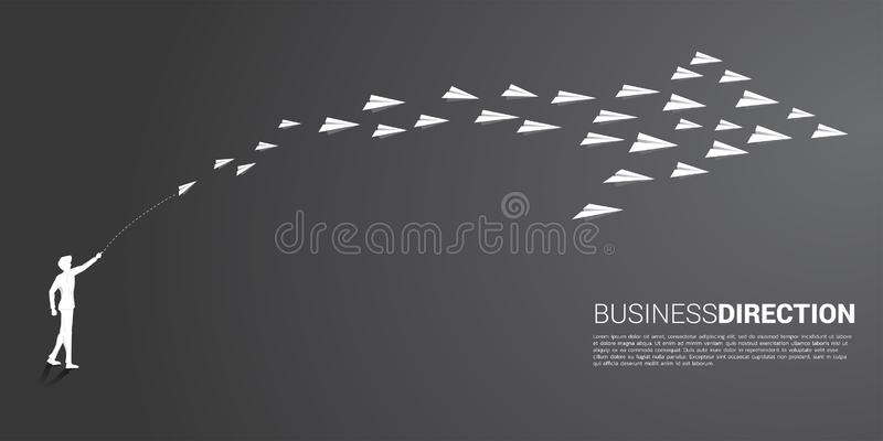 Silhouette of businessman throw out white origami paper airplane is arranged in a shape of big arrow. royalty free illustration