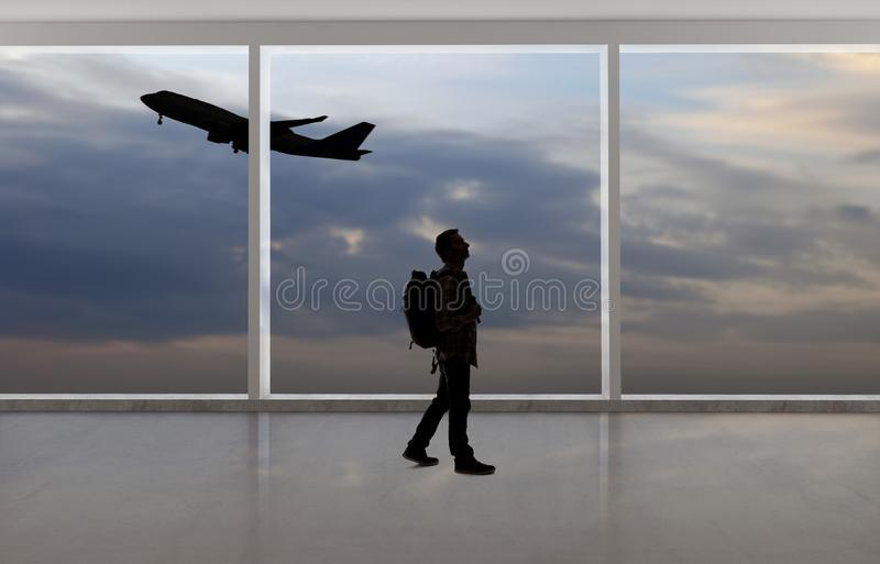 Silhouette of Businessman Traveling at an Airport stock photos
