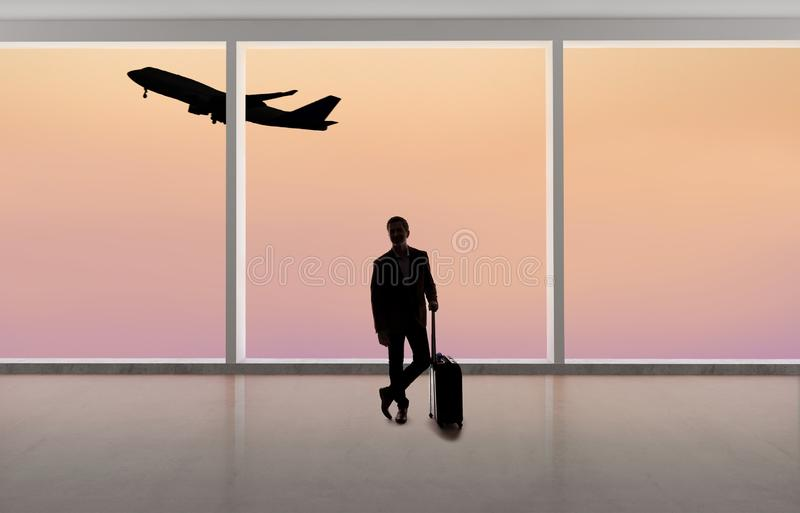 Silhouette of Businessman Traveling at an Airport royalty free stock photos