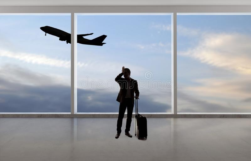 Silhouette of Businessman Traveling at an Airport royalty free stock image