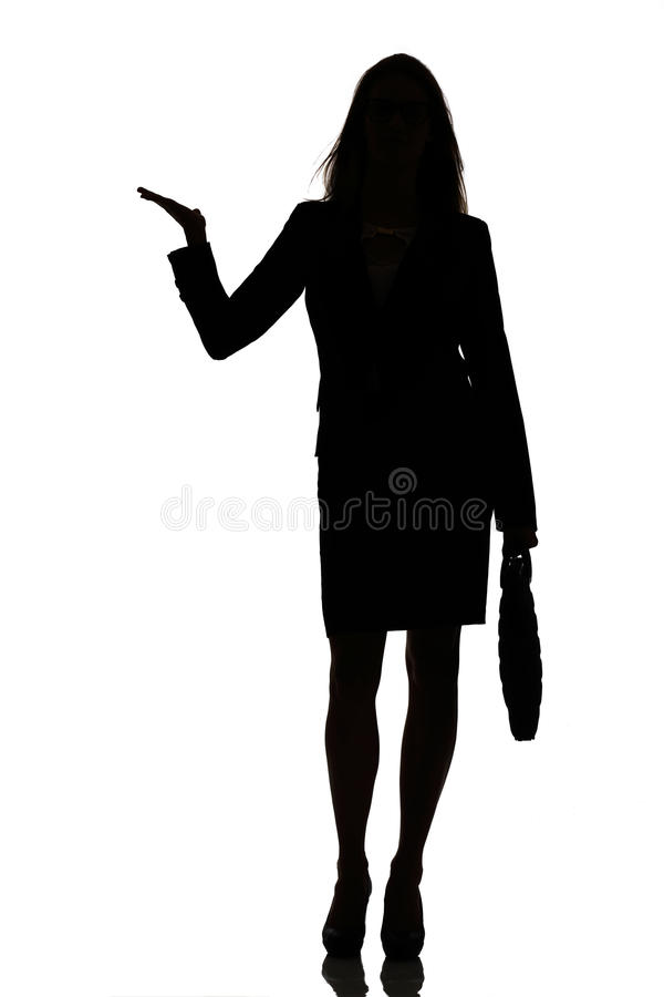 Silhouette of a busy business woman backlight studio. On white royalty free stock photo