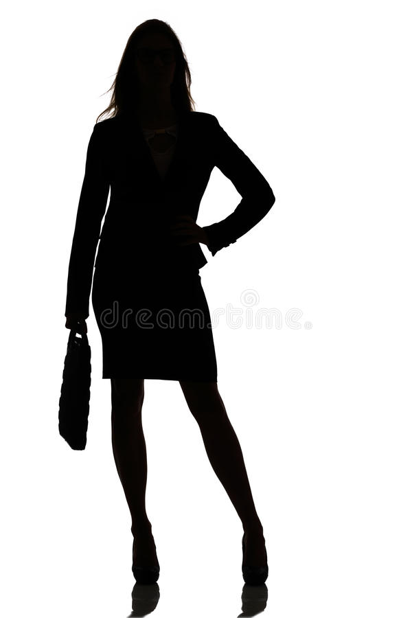 Silhouette of a busy business woman backlight studio. On white stock photos