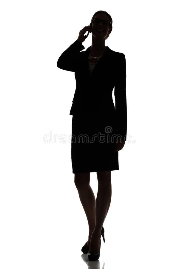 Silhouette of a busy business woman backlight studio. On white stock photography