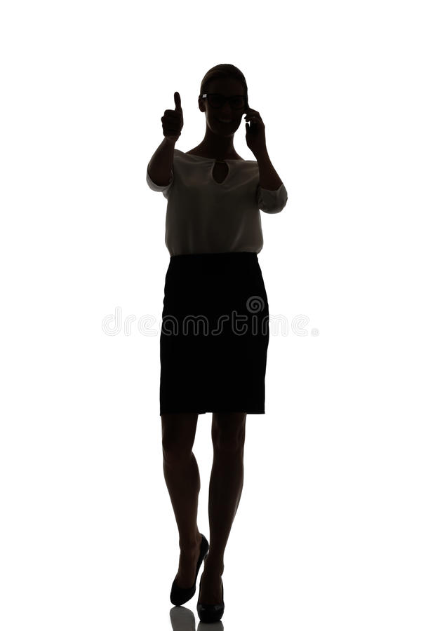 Silhouette of a busy business woman backlight studio. On white royalty free stock photography