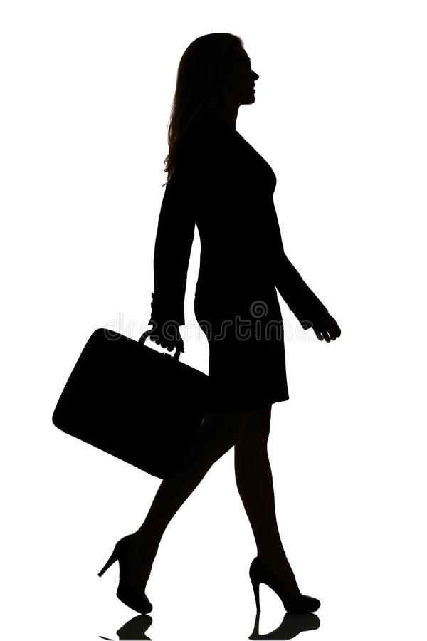Silhouette of a busy business woman backlight studio. On white royalty free stock image