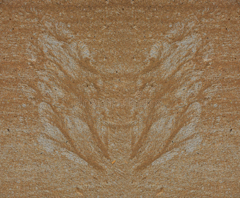 Silhouette of butterfly wings made of sand and gravel by water flow at concrete. Surface stock illustration