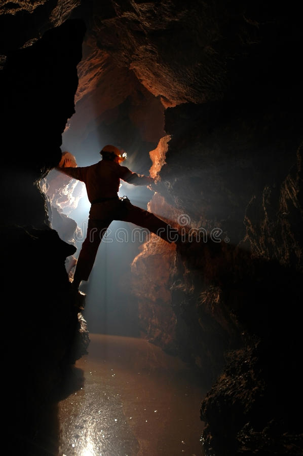 Silhouette of a cave explorer in the underground. Exploring a cave stock images