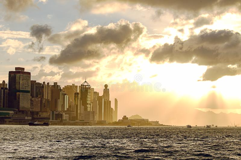 Silhouette central Hong Kong and Victoria harbour at sunset in m royalty free stock image