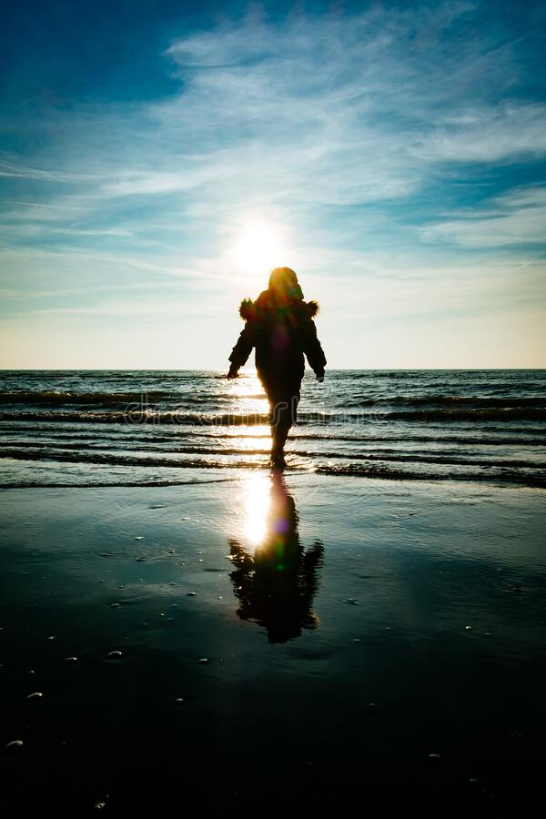 Silhouette of child on beach royalty free stock image