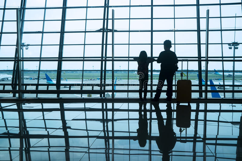 Silhouette children in airport stock image