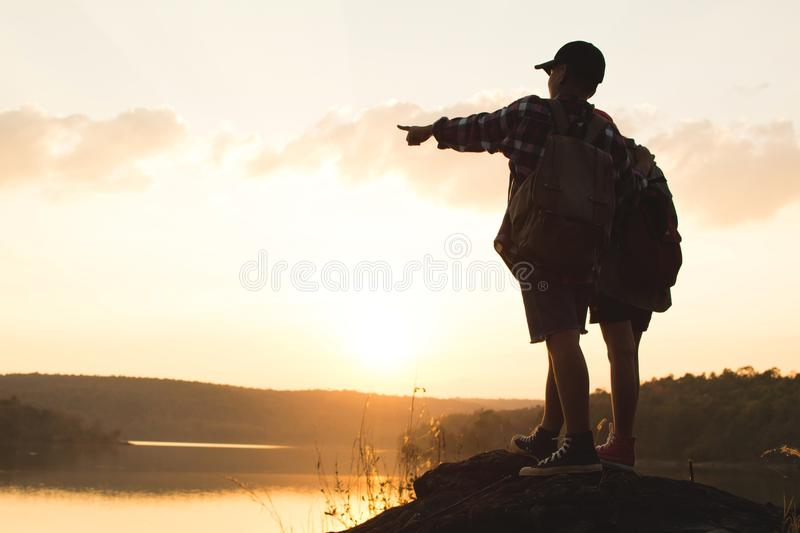 Silhouette of children backpack in nature royalty free stock photography