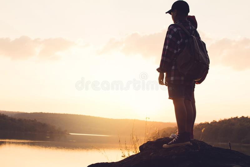 Silhouette of children backpack in nature stock images