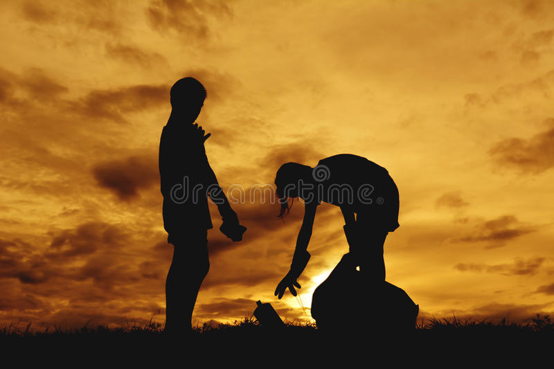 Silhouette of children hands picking up plastic into bin bag royalty free stock images