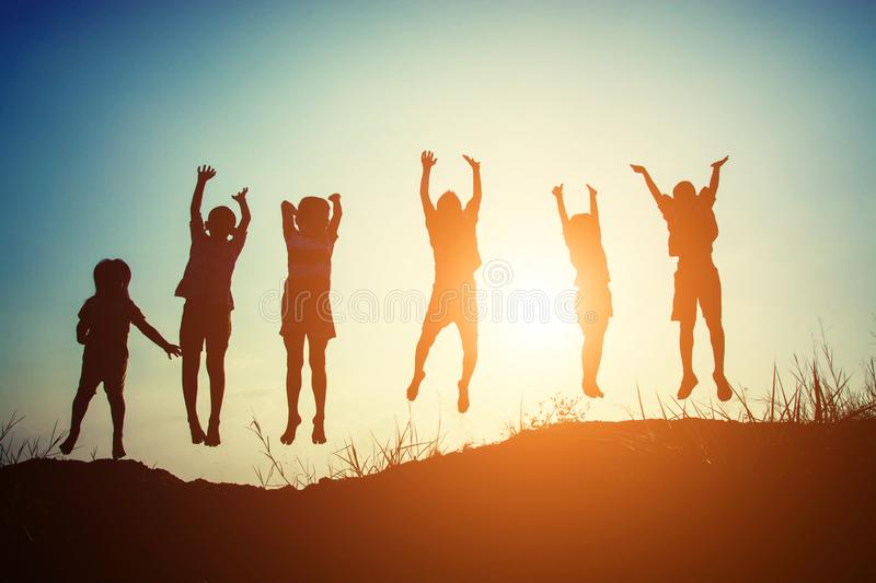 Silhouette of children jump gladness happy time. Background royalty free stock image