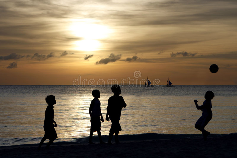Silhouette of Children Playing 2. Silhouette of children playing during sunset at Boracay beach in the Philippines royalty free stock images
