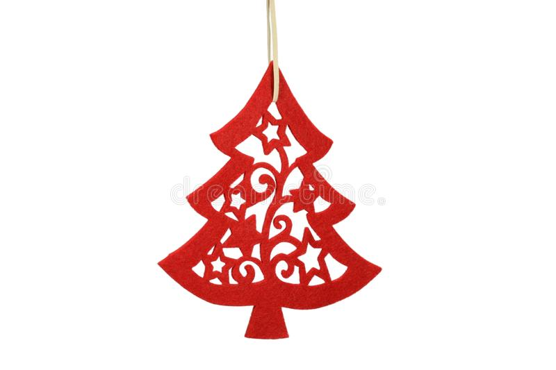 Silhouette Christmas tree. Red silhouette Christmas tree made from felt isolated on white background stock images