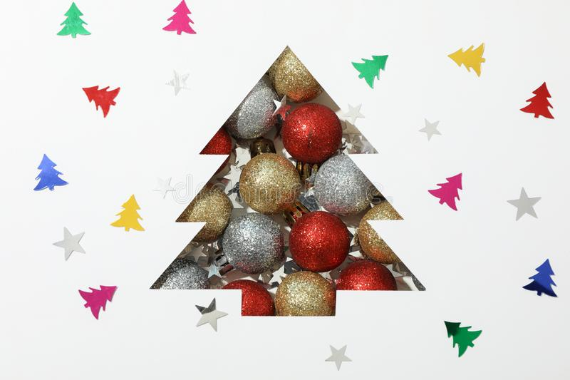 Silhouette of christmas tree with baubles on decorated background. Space for text royalty free stock image