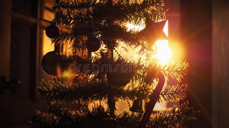 Silhouette of Christmas tree with decoration in sunset stock photos