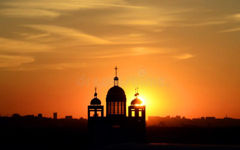Silhouette of the church building at sunset royalty free stock photography