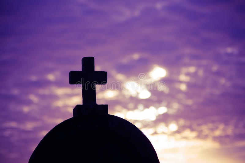 Silhouette of a church top with a cross royalty free stock image