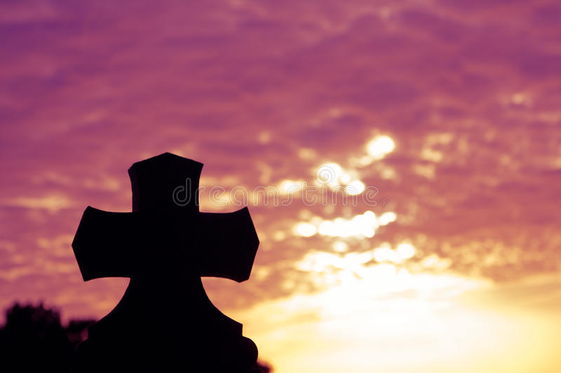Silhouette of a church top with a cross a stock photo