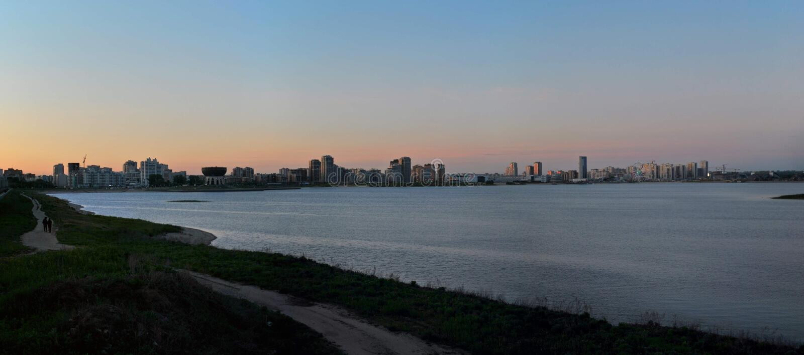Silhouette of the city of Kazan with a view of the river Kazanka against the sunset sky. royalty free stock images