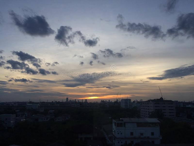 Silhouette of city with sunset on evening stock photography