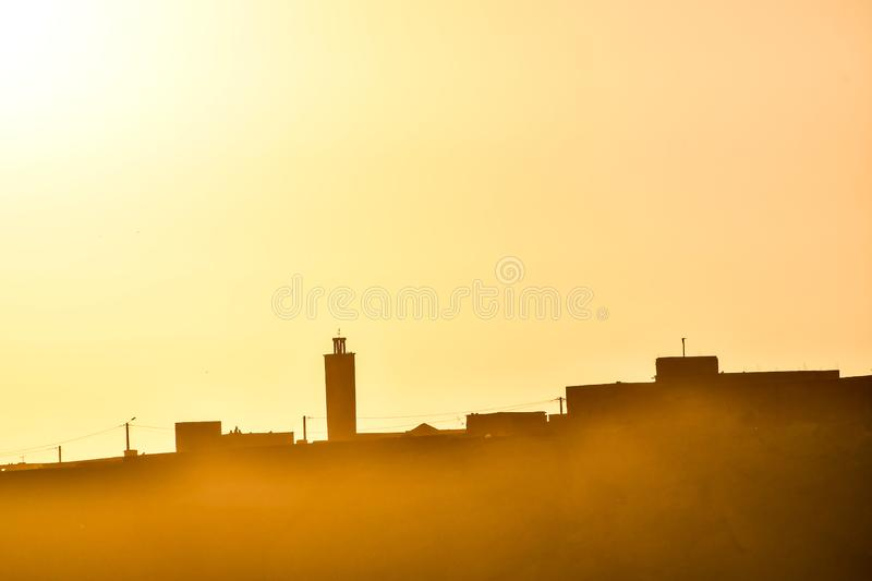 Silhouette of city at sunset, photo as background. Silhouette of city at sunset, beautiful photo digital picture stock photo