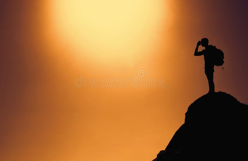Silhouette of a climber on summit with copy space as symbol for stock photography