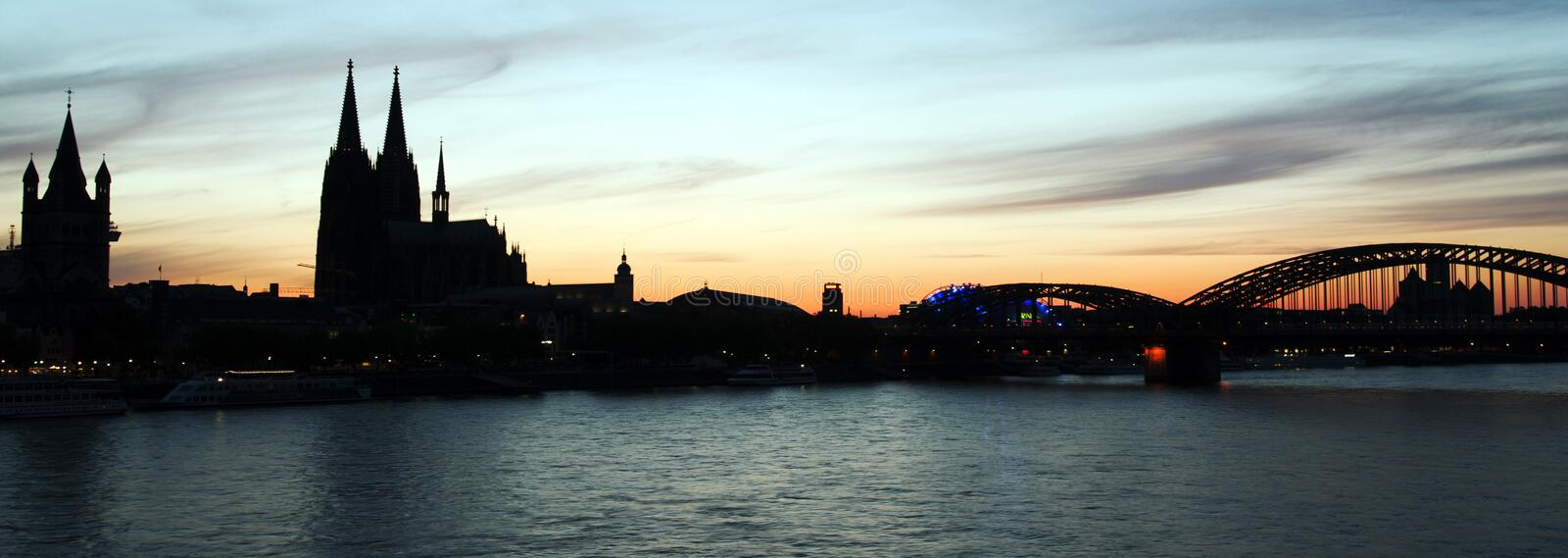 Silhouette of Cologne with Cathedral at sunset royalty free stock photos