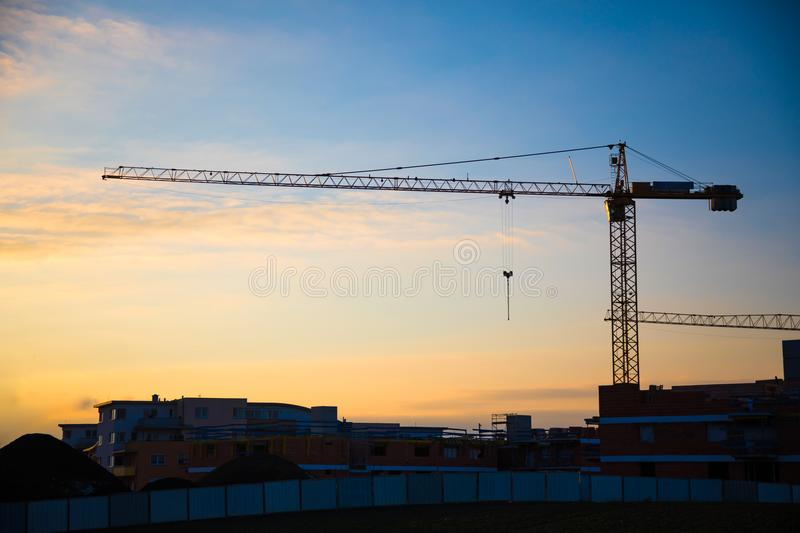 Silhouette of constraction site in working. Silhouette of Modern constraction site in working at sunset time royalty free stock images