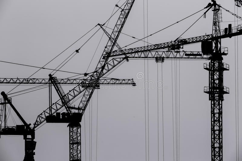 Silhouette construction crane royalty free stock photography