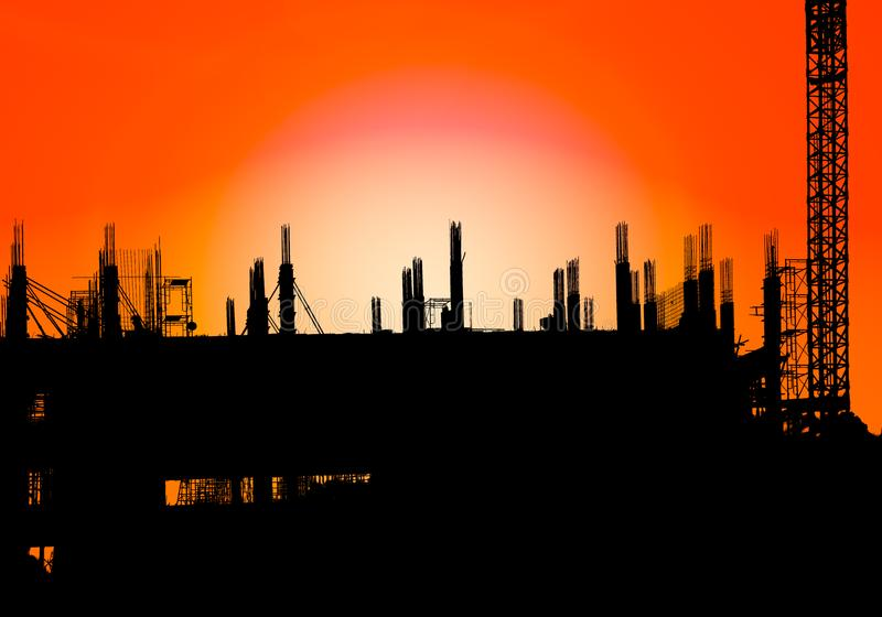 Silhouette of construction on industry site at concept sunrise time with sun light effect background with copy space add text stock image
