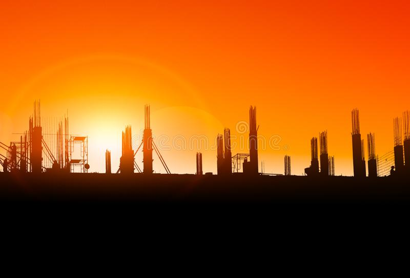 Silhouette of construction on industry site at concept sunrise time with sun light effect background with copy space add text stock photos
