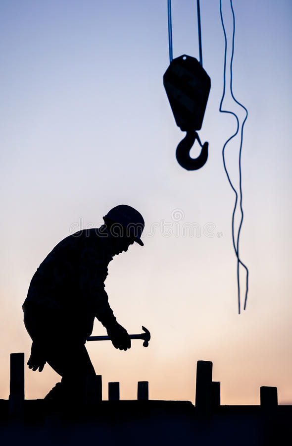 Silhouette of construction worker stock photos