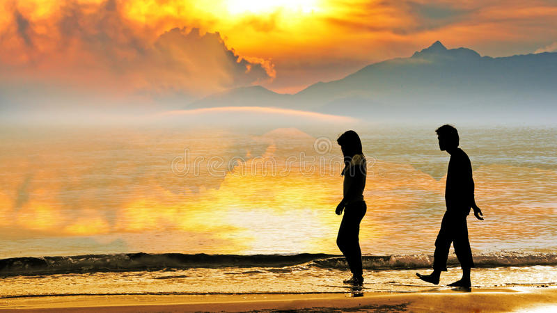 Silhouette of a couple on the beach royalty free stock image