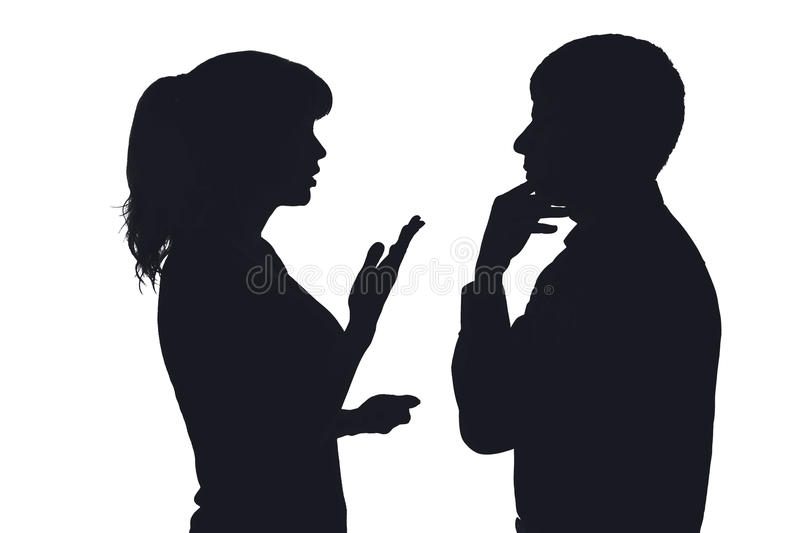 Silhouette of a couple discussing family problems stock image