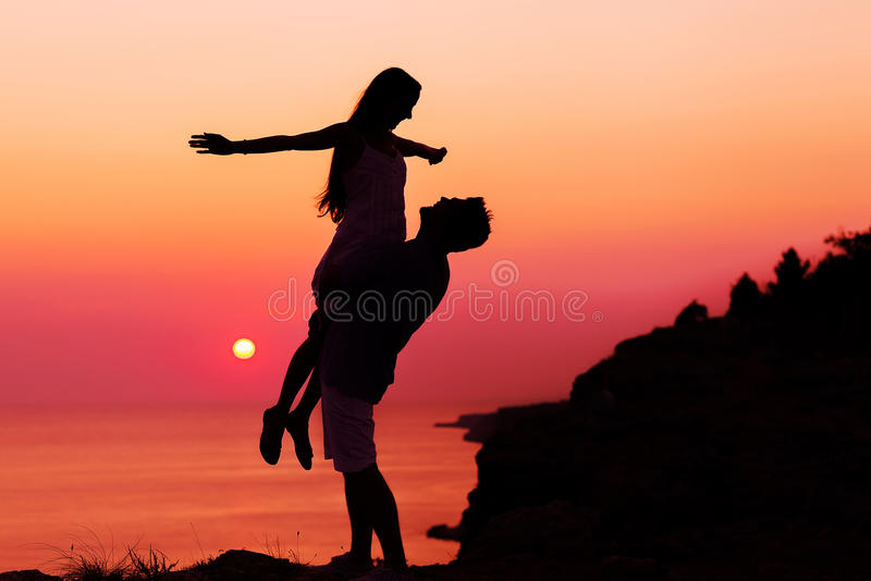 Silhouette couple in love stock photos