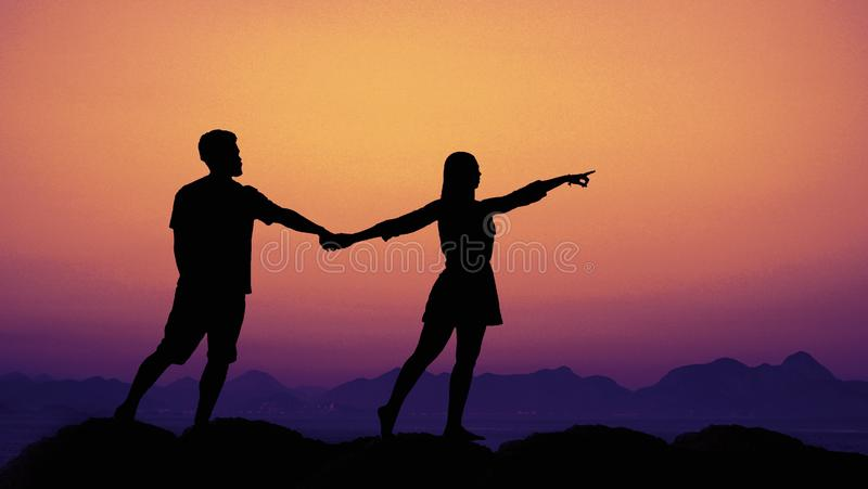 Silhouette of a couple in love at sunset as symbol for wedding stock image