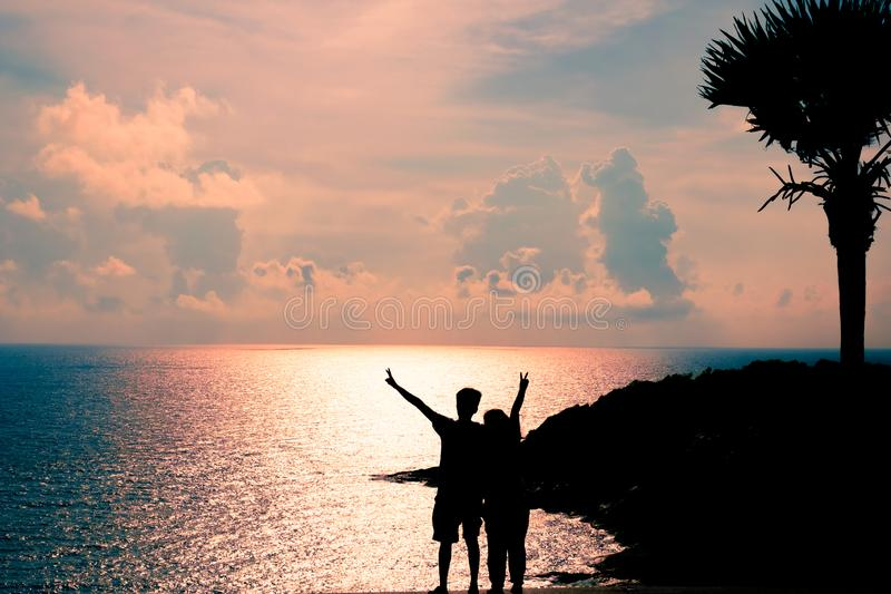 Silhouette of Couple with Seascape royalty free stock image