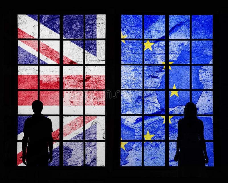 Couple and Uk and Eu damaged flags royalty free stock photography